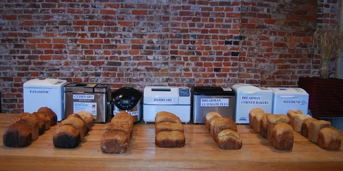 Seven Different Bread Makers On Table